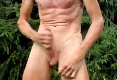 Skinny jock rubbing one outdoors