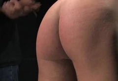 Hot man Chase is hoised and spanked for a red butt