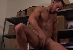 Handsome solo hunk toying his ass with dildo