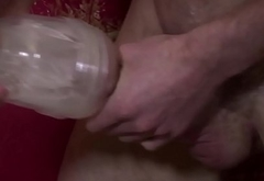 Muscular solo brit fucking a fleshlight
