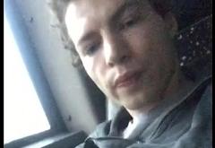 Curly guy cumming on public bus