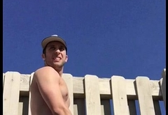 Fit guy cum in the sun on the roof