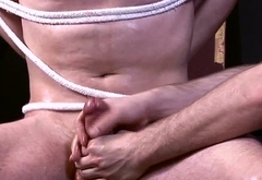 Restrained underwear lad gets oily handjob