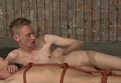 Ashton Bradley gives Kris Blent a kinky handjob treatment