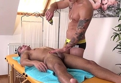 Handsome twunks cock tugged during massage