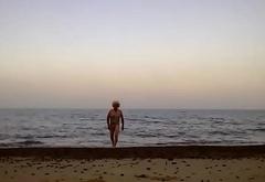 sissy ken in swimsuit on beach