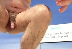 At the nudist beach