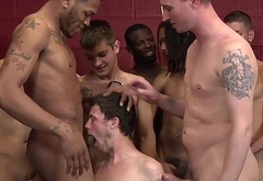 Twink is on his knees getting fucked and cum covered - Bukkake Boys